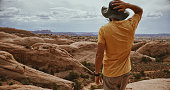 istock Explorer man hiking near Canyonlands, Moab: South West USA adventures 1207274516