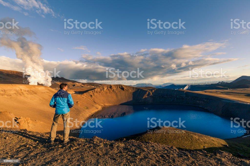 Explorer overlooking Viti crater near Krafla lava fields stock photo