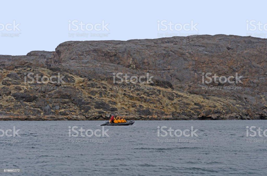 Explorers Cruising the Arctic in a Raft stock photo