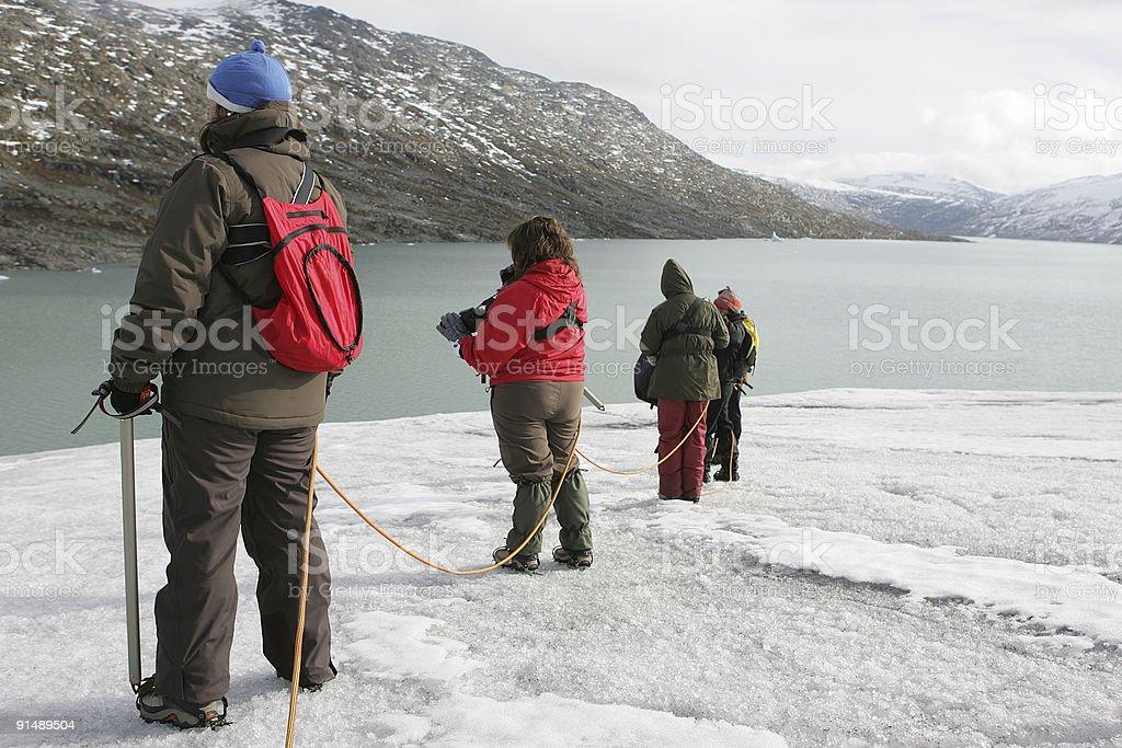 explorers in a glacier royalty-free stock photo