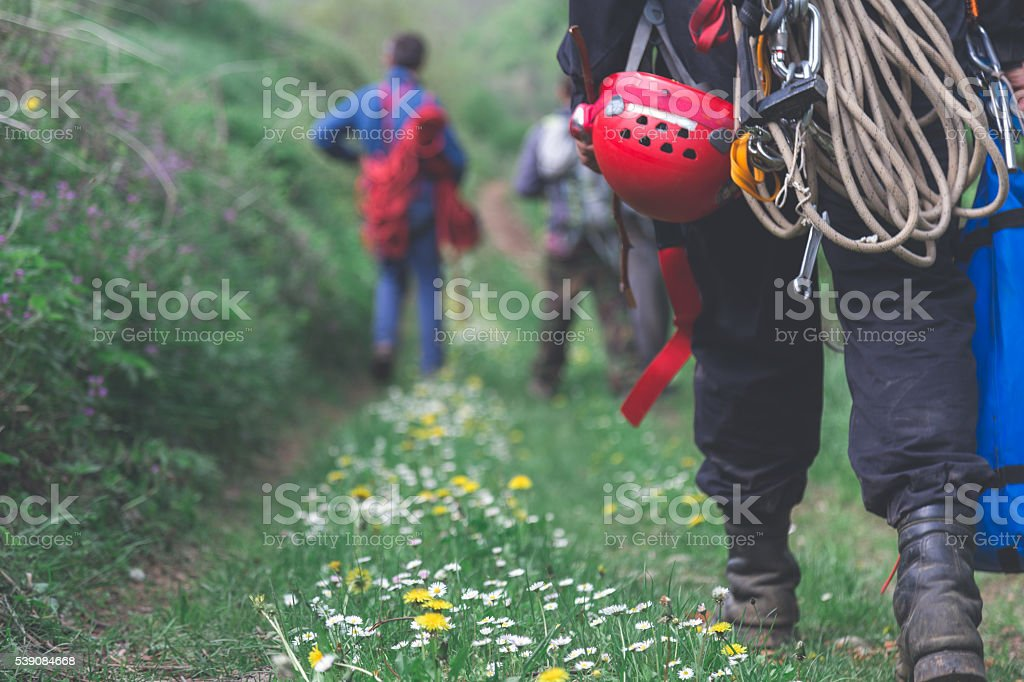 explorers walking on a green path stock photo