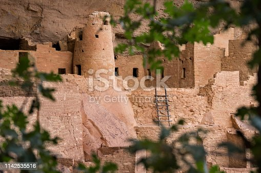 Cliff Palace framed by tree leaves, Ancient Puebloan (Anasazi)  housing, Mesa Verde National Park, Colorado, USA