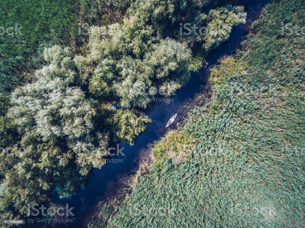 Exploring Danube Delta with a Canoe stock photo
