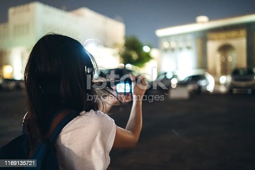 Young beautiful caucasian woman exploring Doha with camera.