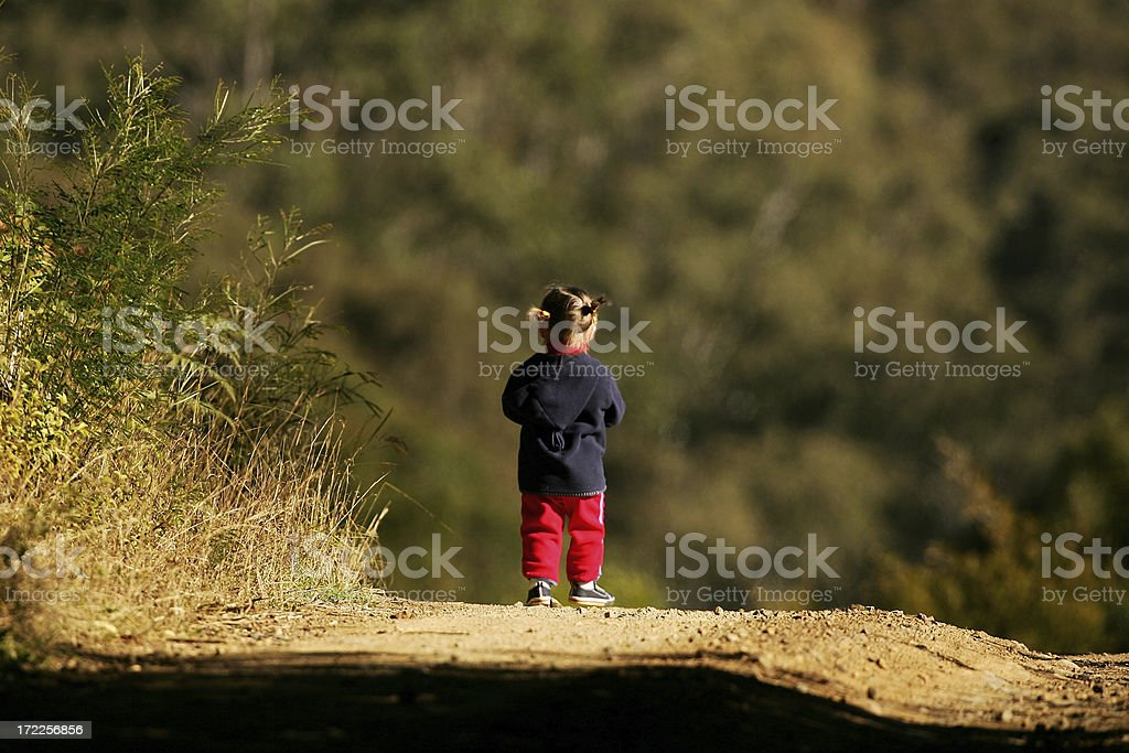 Exploring over the hill stock photo