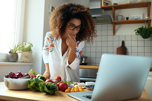 Girl exploring the web for delicious recipes