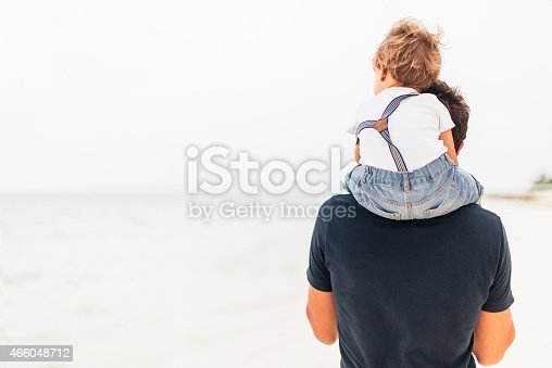 Father and son spending day together on the beach