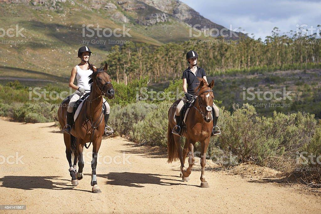Exploring the countryside on horseback stock photo