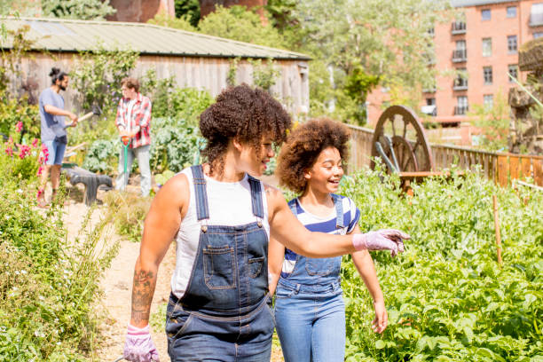 Exploring the Farm A woman and child walk through the farm community garden. community garden stock pictures, royalty-free photos & images