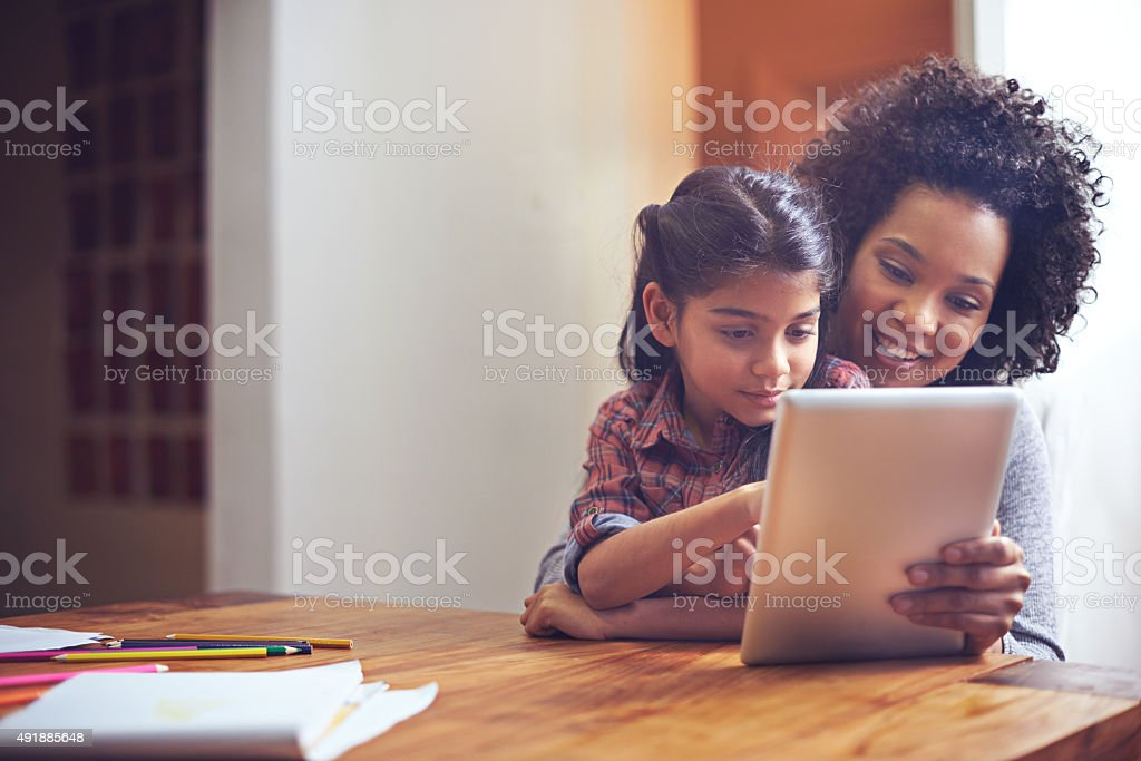 Exploring the online world with mom stock photo