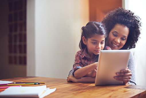 Exploring The Online World With Mom Stock Photo - Download Image Now