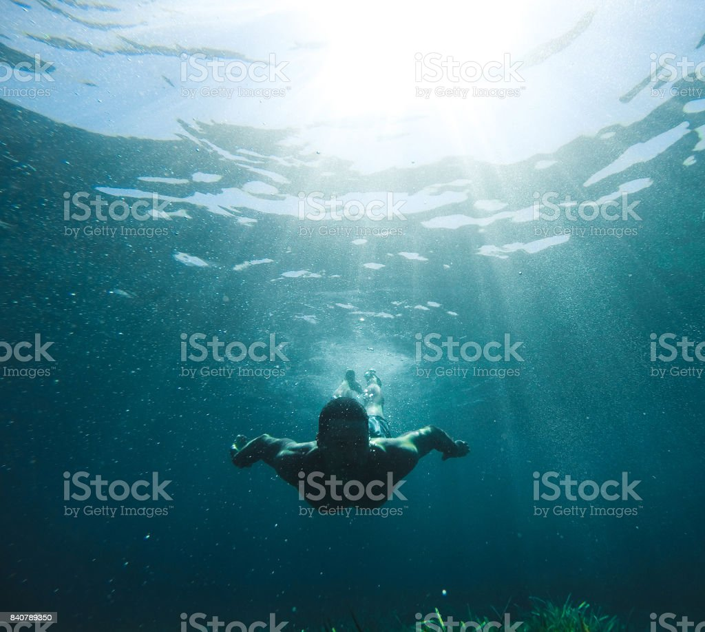 Exploring under the water stock photo