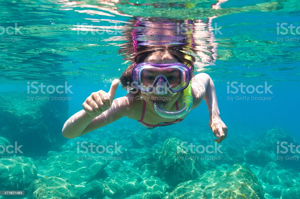 exploring underwater stock photo