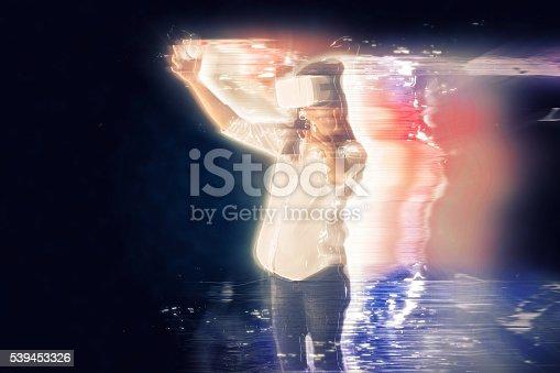 Woman is exploring her virtual reality simulator world.