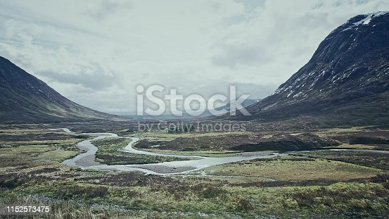Mountain peaks and hills covered with grass. Rainy day. Scotland