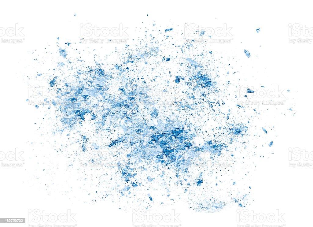 explosion blue ice fragment on white background stock photo