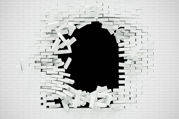 Explosion, destruction of a white brick wall, abstract background for - foto de stock