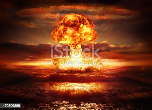 testing of atomic bomb over ocean with mushroom clouds - red destroy