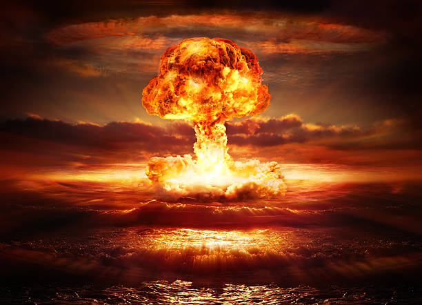 explosion nuclear bomb in ocean testing of atomic bomb over ocean with mushroom clouds - red destroy burst stock pictures, royalty-free photos & images