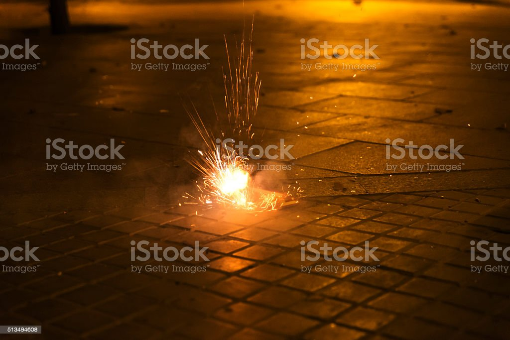 Explosion of a firecracke on a street stock photo