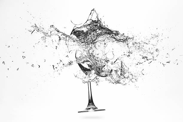Explosion of a glass with water stock photo
