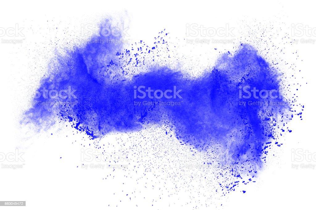 Explosion of blue powder on white background. stock photo