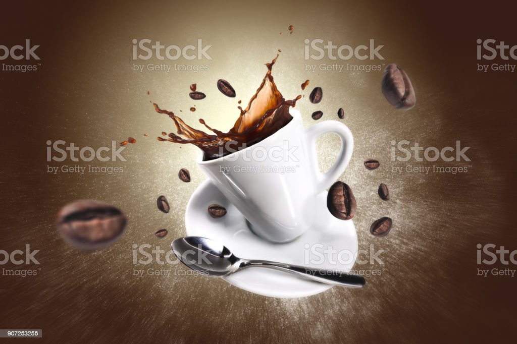 Explosion of coffee with a cup and beans - foto stock