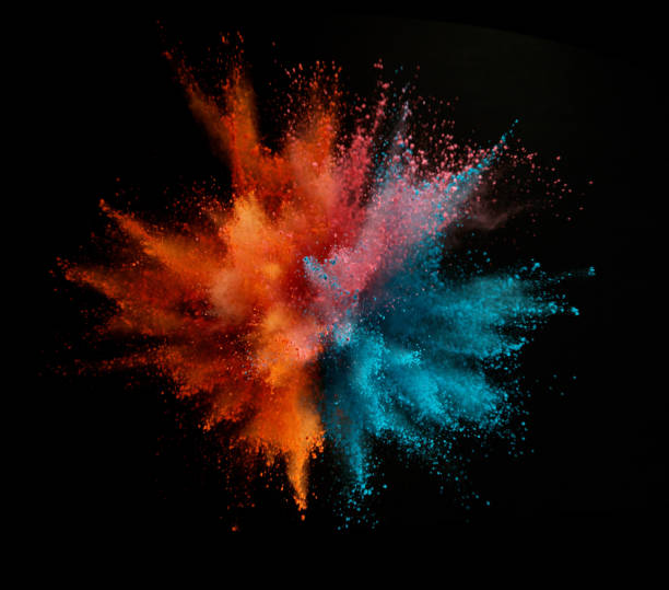 Explosion of colored powder isolated on black background stock photo