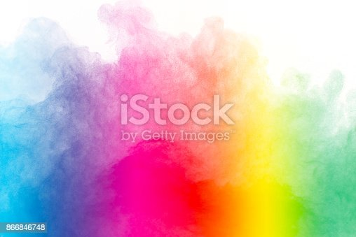 istock Explosion of colored powder isolated on white background. 866846748
