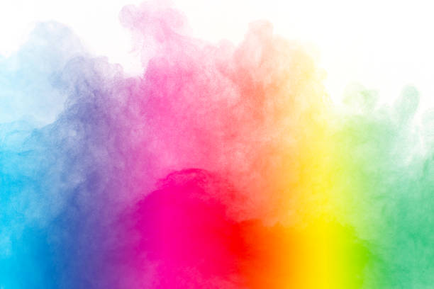 explosion of colored powder isolated on white background. - abstract multicolored powder explosion stock photos and pictures