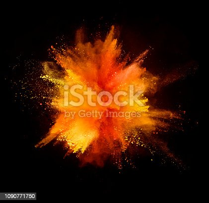 istock Explosion of colored powder on black background 1090771750