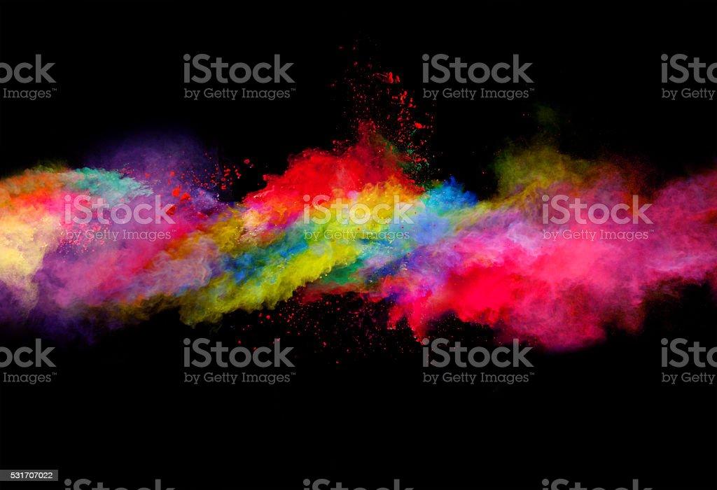 Explosión del polvo de color en fondo negro foto de stock libre de derechos