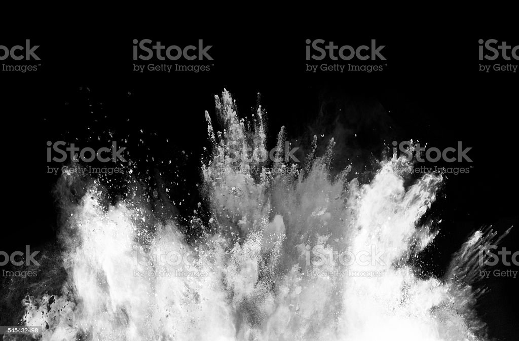 Explosion of colored powder on black background stock photo