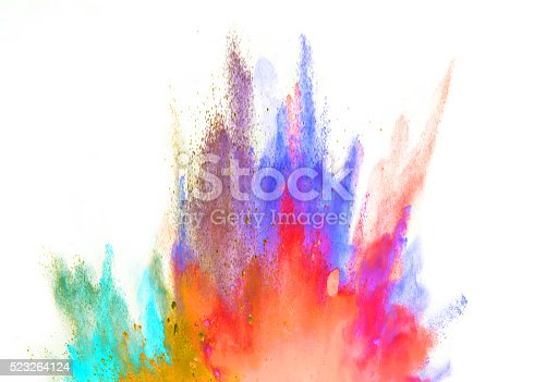 istock Explosion of colored powder on white background 523264124