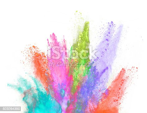 istock Explosion of colored powder on white background 523264350