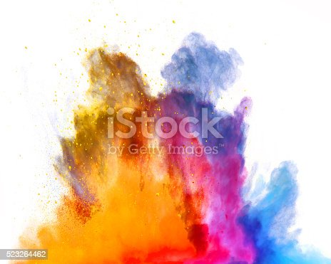 istock Explosion of colored powder on white background 523264462