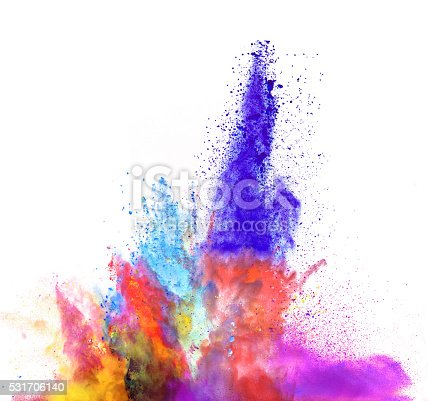 istock Explosion of colored powder on white background 531706140