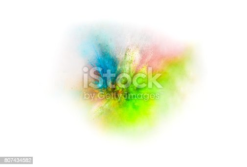 istock Explosion of colored powder on white background 807434582