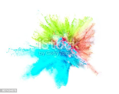 istock Explosion of colored powder on white background 807434678