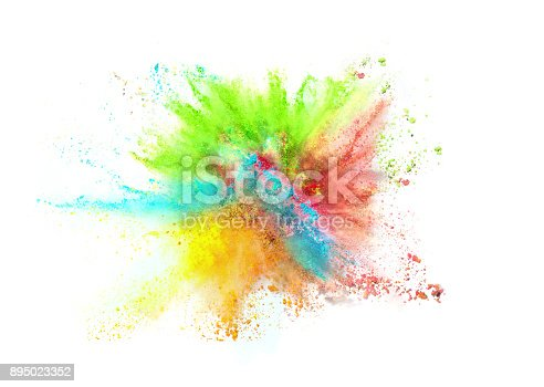 istock Explosion of colored powder on white background 895023352