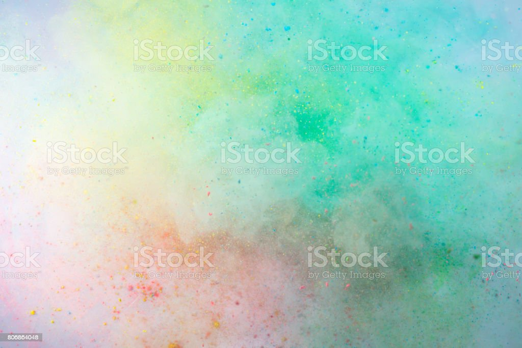 Explosion of colored powder stock photo