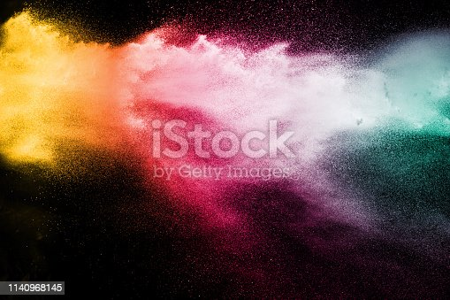 istock Explosion of colorful powder on black background. Splash of color powder dust on dark background. 1140968145