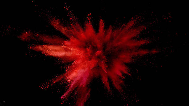 explosion of coloured powder on black background. - vermelho imagens e fotografias de stock