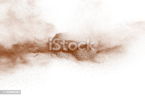 istock Explosion of deep brown powder on white background. 1140966362