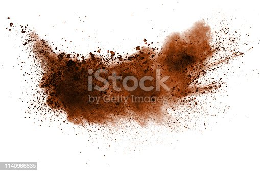 istock Explosion of deep brown powder on white background. 1140966635