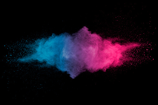 istock Explosion of multicolored dust on black background. 1132089170
