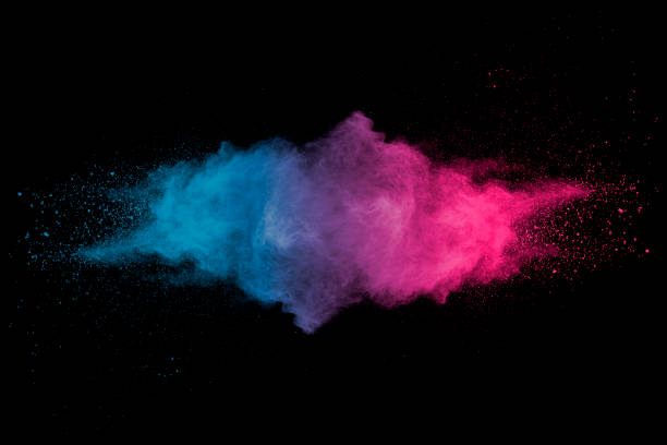 Explosion of multicolored dust on black background. Stopping the movement of multicolored dust on black background. smoke physical structure stock pictures, royalty-free photos & images