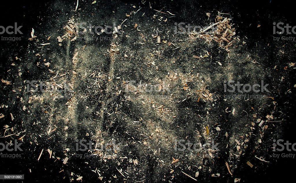 Explosion of sawdust on black background. stock photo