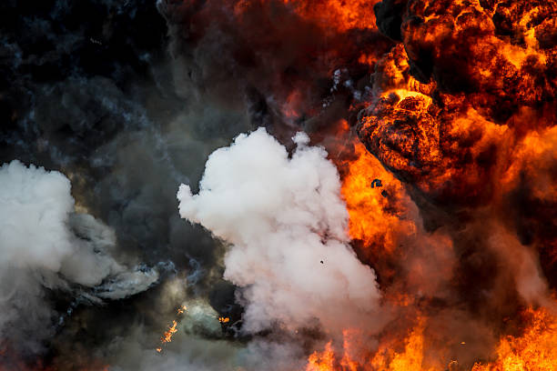 Explosion - smoke and flames A controlled explosion with black smoke and orange flame.  terrorism stock pictures, royalty-free photos & images