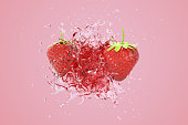 Explosion Strawberry juicy liquid with Strawberry fruit on pink background. 3D Render.
